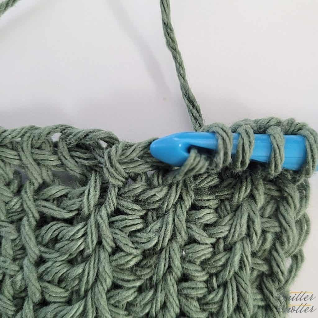 Twisted Simple / Afghan stitch - 2 ways - twisted down photo tutorial - step 1  Simple crochet stitch to build a tunisian crochet stitch pattern.