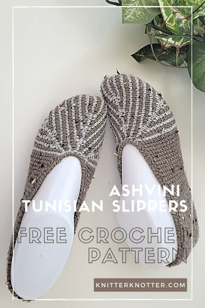 Tunisian crochet slippers - fun and easy to make once you understand how to work the short rows.  Picture contains a pair of Tunisian crocheted slippers in two colors next to a bunch of leaves.