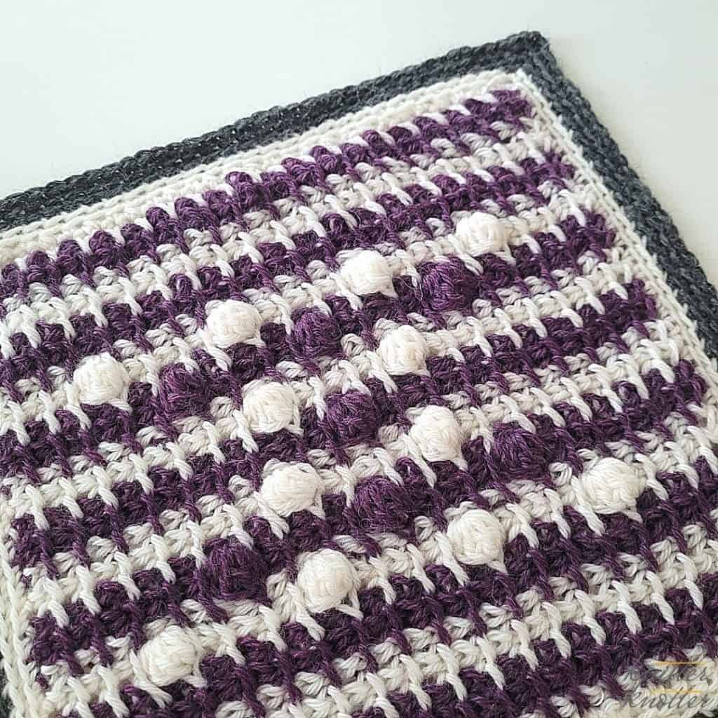 Crochet stitches for blankets - used tunisian bobble stitch and tunisian X stitch worked together.