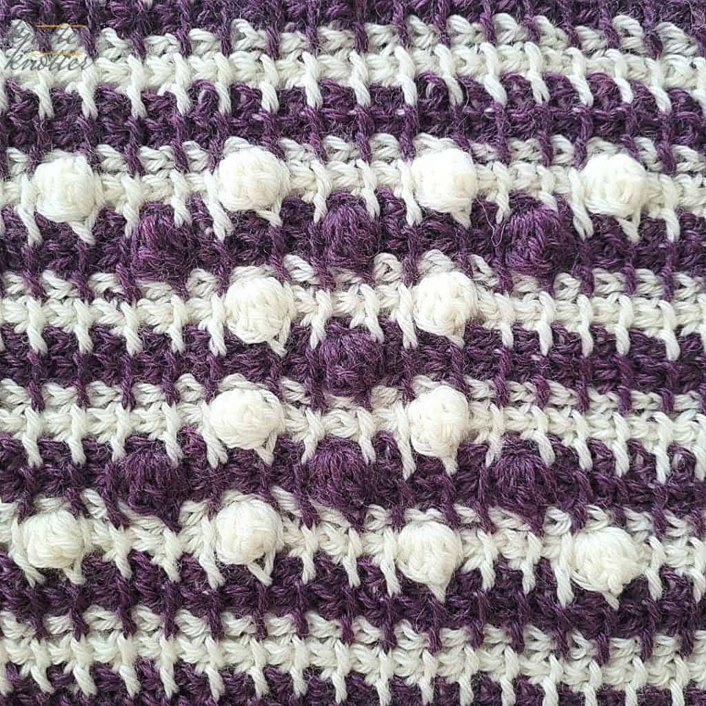 Close up of the eleventh block of the crochet afghan from KnitterKnotter Blanket CAL of 2021