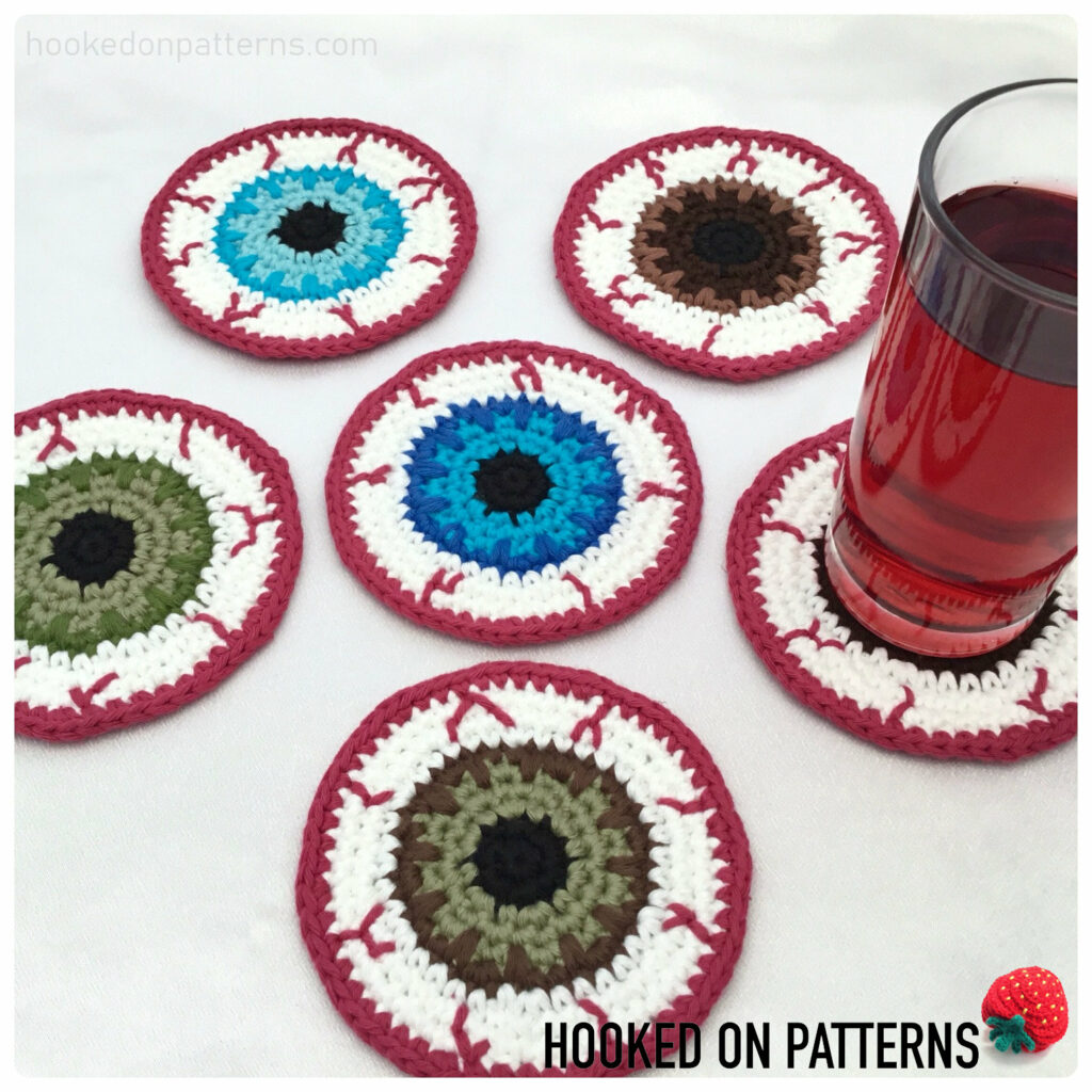 Eyeball Coasters by Hooked On Patterns are something that can be made with less than 50 g of yarn.