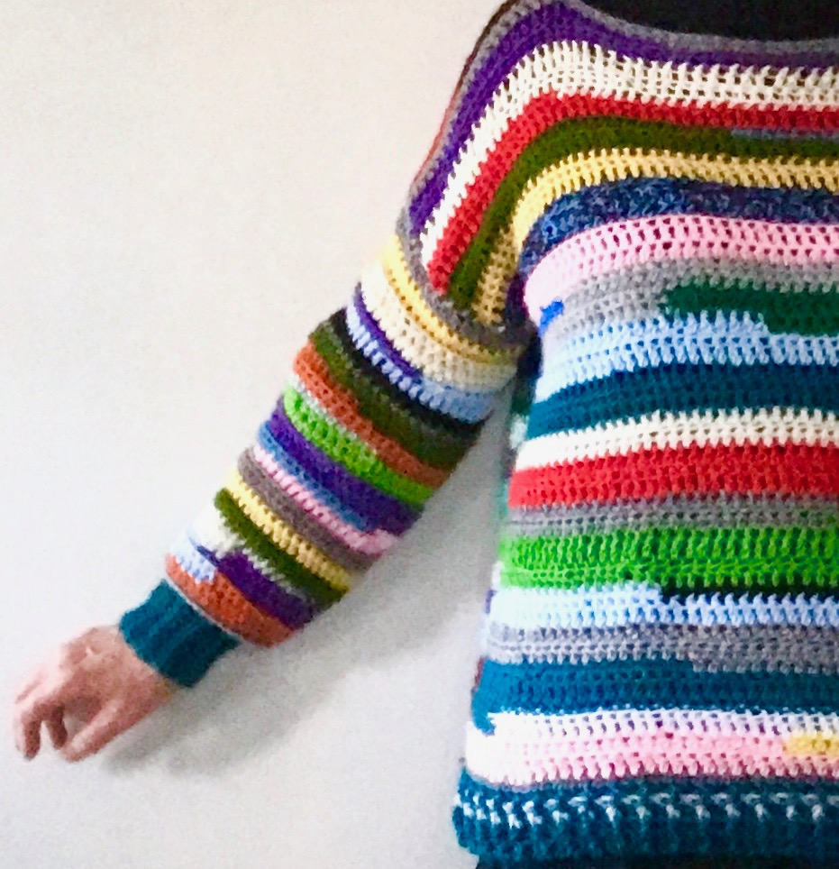 What can you do with your yarn stash? Make this bright and colorful Happy Scrappy Sweater by Carroway Crochet.