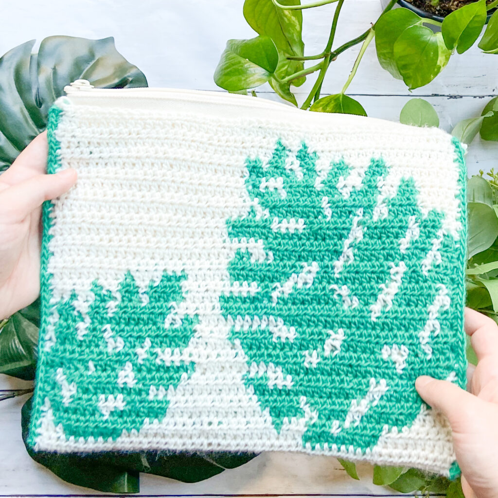 The Monstera Clutch by Eclaire Makery uses tapestry crochet and is the perfect trick for blasting through your yarn stash!
