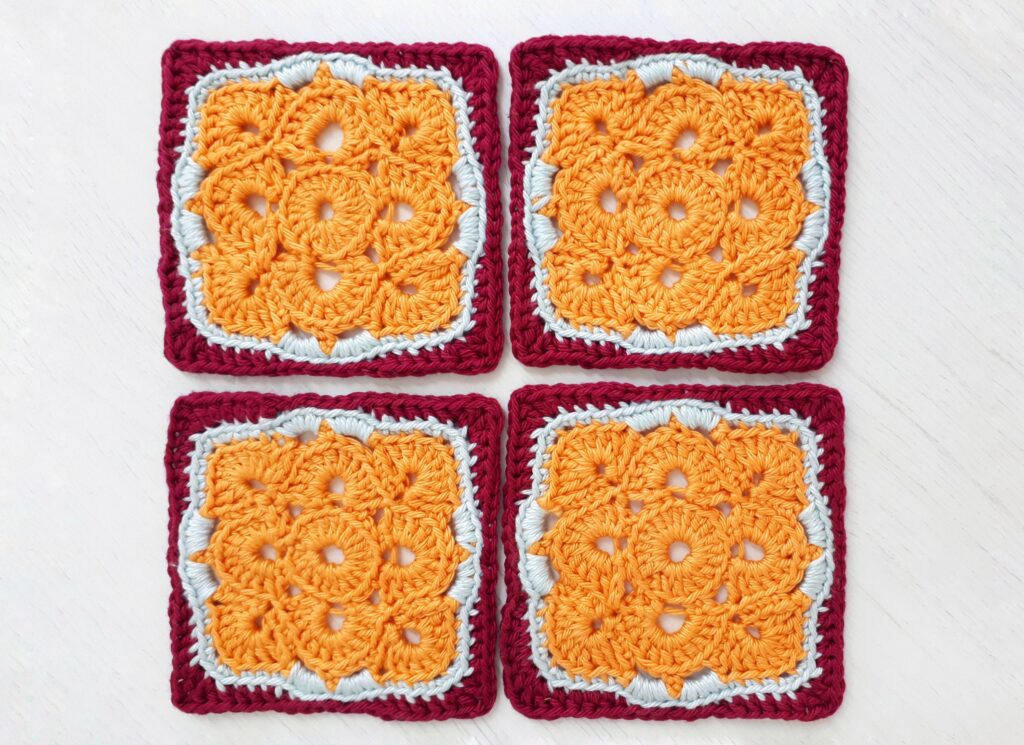 These square flower coasters are perfect stash busters and use very little yarn. Make a bunch of these and they would make a great afghan or bag when joined!