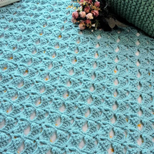 Magical Butterfly Throw by Crochet Kim made with a lovely lace pattern - #20 in the 20 Unique and Beautiful Crochet Blankets Round Up by Knitterknotter.