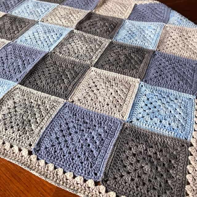 Mateo's Granny Square Blanket by Cypress Textiles made using granny square motifs - #9 in the 20 Unique and Beautiful Crochet Blankets Round Up by Knitterknotter.