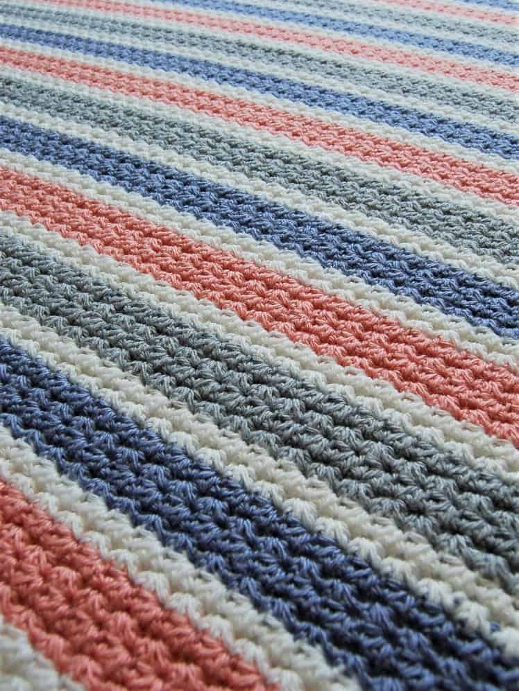 Modified Trinity Stitch Blanket by Warmest Welcome Crafts - #14 in the 20 Unique and Beautiful Crochet Blankets Round Up by Knitterknotter.