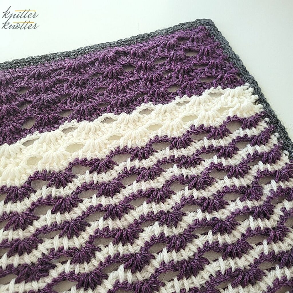 Angled picture of the 16th square of the Tunisian Blanket CAL '21. Crochet stitches for blankets - used Tunisian simple stitch.