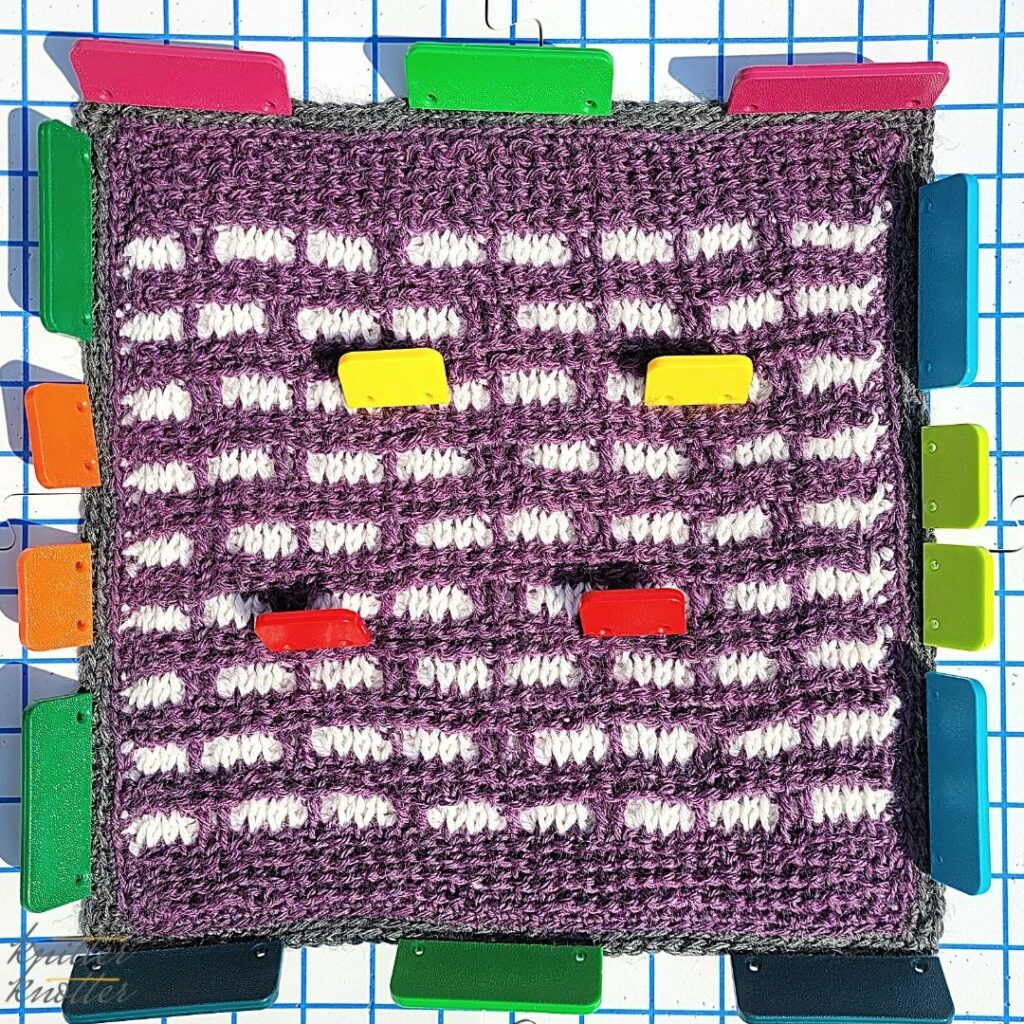 Blocking the block designed by Knitter Knotter - mosaic crochet using tunisian knit stitch, tunisian reverse stitch and overlay stitches - 2021 CAL hosted by KnitterKnotter