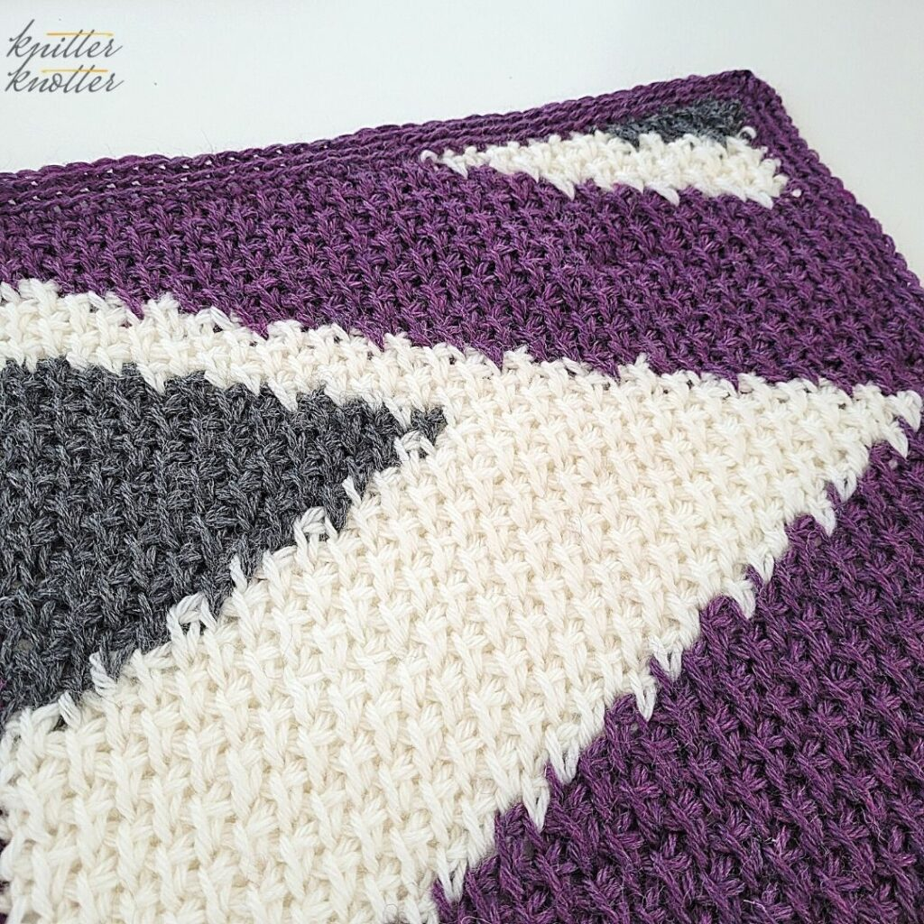 Crochet stitches for blankets - used tunisian simple stitch and tunisian knit stitches worked together. This is an angled view of the 19th square of the Tunisian blanket CAL '21.