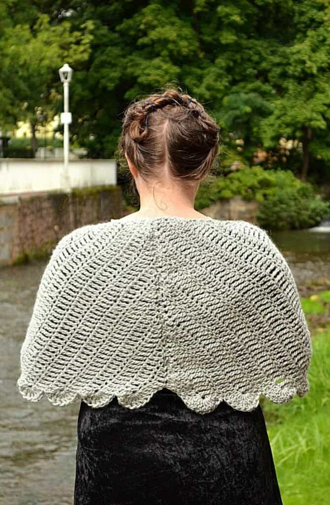 Andrea Cretu is wearing he Dove Wings shawl that is available as a free crochet pattern on knitterknotter.com.