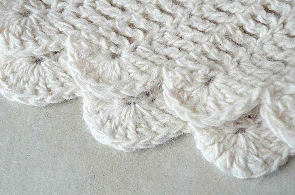 A close up of the wings of the Dove Wings Shawl by Andrea Cretu.