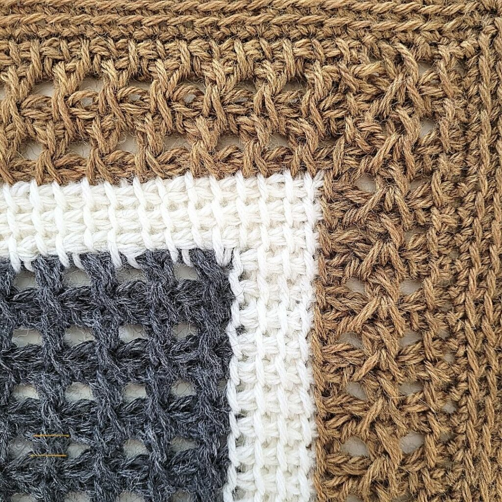 Close up of the twenty first block of the crochet afghan from KnitterKnotter Blanket CAL of 2021