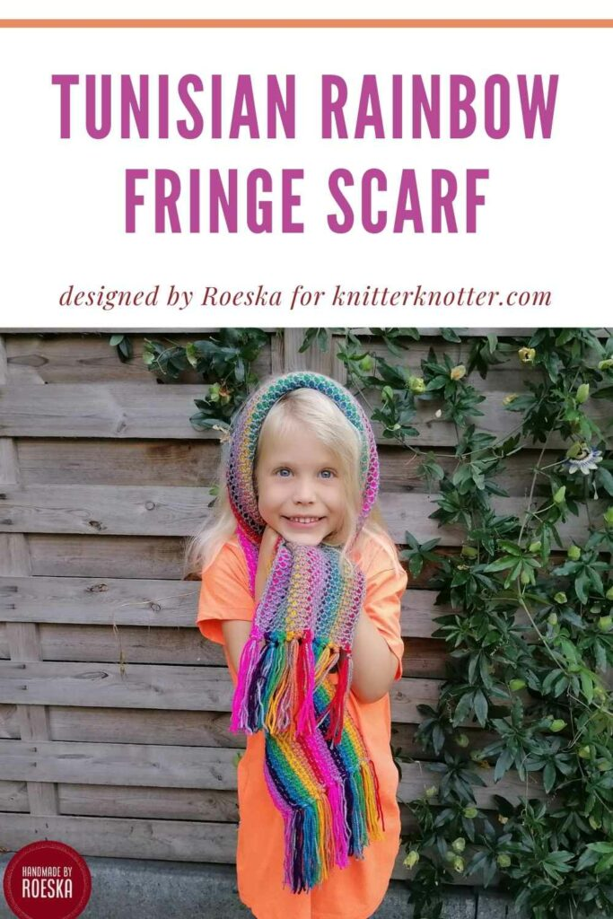 This Free Tunisian crochet rainbow fringe scarf pattern is great for using up your scraps. It comes in 2 sizes (adult and child) and features a beautiful fringe at the ends. This is a pinnable image for Pinterest.