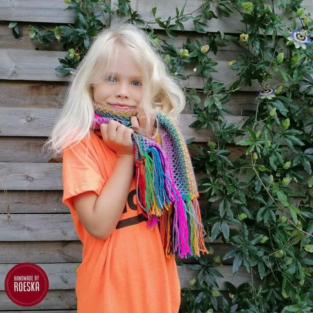 The Tunisian Fringe Rainbow Scarf being modeled by Roeska's daughter who claimed it as her own since it is so fringie and beautiful!